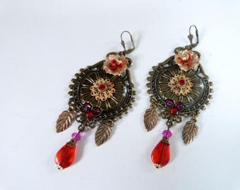Large baroque and bohemian earrings .