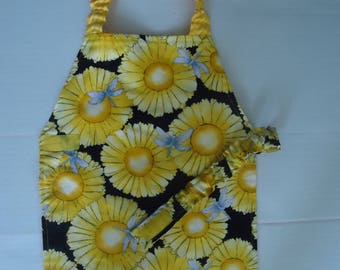 Bright yellow flower print apron. Fully Lined.Great for the little baker, crafter in your life.  Sunny Sunny days.  Ready to ship