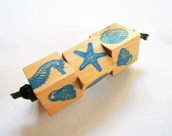 Wood puzzle cubes of matching sea shells and sea horse for travel and quiet play old fashioned fidget