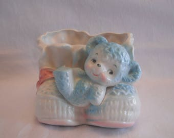 Vintage Bear Planter, Laying On A Set Of Baby Booties, Pink, Blue And White
