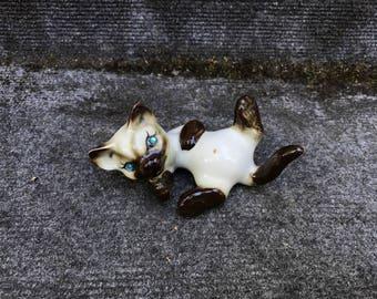 Vintage Siamese Cat Kitten Figurine Made In Japan Blue Rhinestone Eyes Laying Down