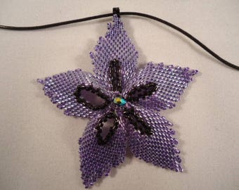 Purple and black flower bead pendant