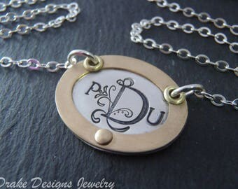 personalized gold rimmed monogram necklace personalized in mixed metals