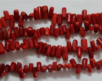 a strand of 85 shape red coral chips beads