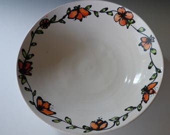white bowl with flower garland