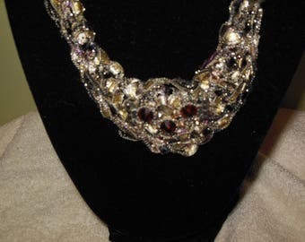 Black and Gold Bib Necklace with Red Medallion