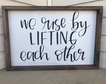 Inspirational Sign - We Rise By Lifting Each Other