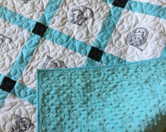 A modern quilt in black , white and aqua, hand pieced and machine quilted by me.