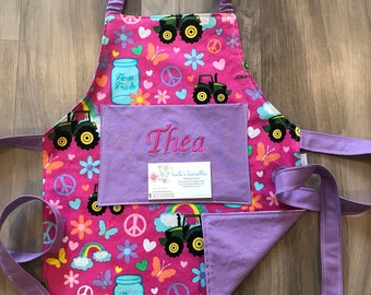 Toddler girls tractor personalized apron, made from licensed fabric