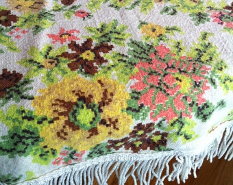 A Round Floral Tablecloth With Fringe