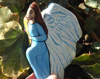 painted rock angel with harp