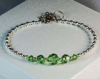 "Cynthia Lynn ""CELEBRATE"" Swarovski Crystal Sterling Silver August Birthstone Bangle Bracelet with Clasp"
