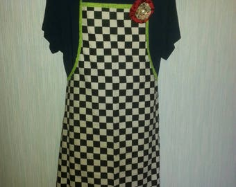 Black and white checkered apron.