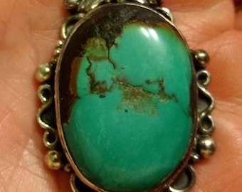 Vintage Native American Sterling Silver and Turquoise Ornate Oval Necklace Pendant