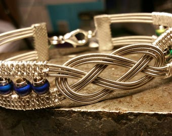 Wire-Wrapped Guitar String Bracelet with a Celtic Knot & Mood Beads