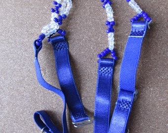 Royal blue beaded stretchy adjustable. Will jazz up outfit - will not give support