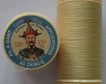 Spool of thread color 330 puppet