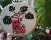 La Croix with monstera detail embroidery
