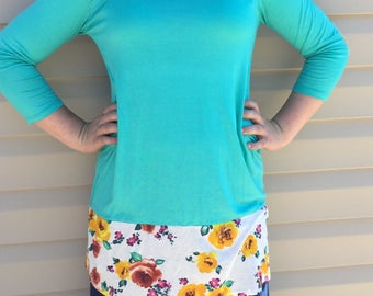 Turquoise tunic with buttons and floral. BRAND NEW with Tags