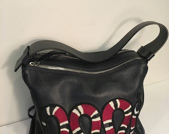 Navy leather hand bag with red snake applique