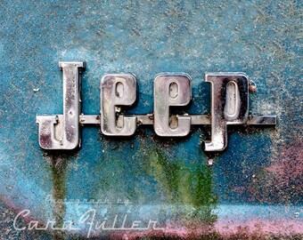 Jeep Emblem on blue car Photograph