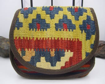 Multi coloured carpet and man made suede cross body bag