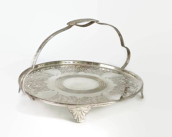 Silver plated cake plate with fixed handle, pierced metal work pattern, floral and Greek inspired handle pattern, mid 20th century