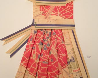 Artfully folded paper dress made from a reproduction paper map.