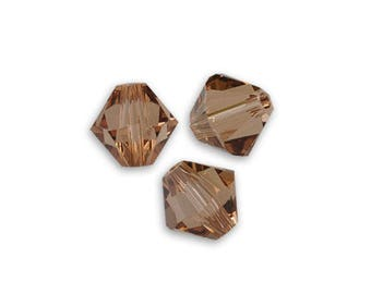 10 6 mm bicone light smoked topaz Swarovski Crystal bead