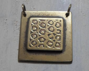 etched pendant