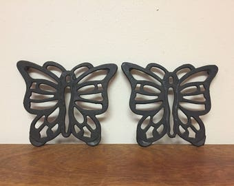 "Two 6.5"" Butterfly Black Cast Iron Trivets, Made in Taiwan"