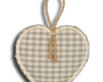 Pretty little heart hanging in off white gingham fabric