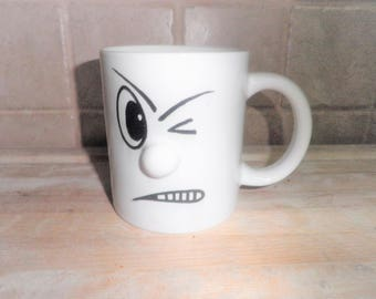 Vintage coffee mug with winking face