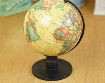 Small vintage globe, parchment colour on black stand