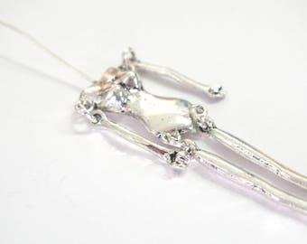 Silhouette pendant in silver metal 11, 5 x 1, 8cm