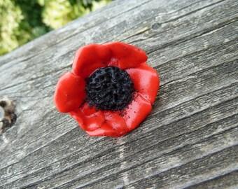 Poppy passion black heart ring