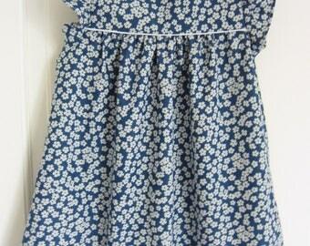 soft denim girl with flowers dress