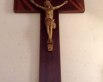 Vintage Wooden Crucifix with metal figure of Christ. Could be brass. Measures 11.75inches by 6inches.