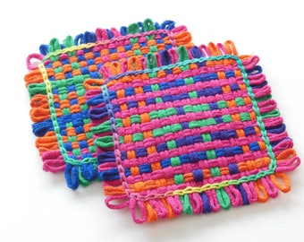 Two woven potholders or two extra large coasters, pink, orange, yellow, green, blue, violet, and renaissance kitchen decor, all cotton