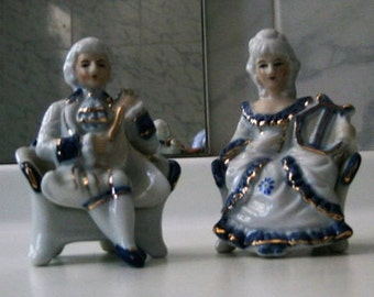 Porcelain musicians couple group. Figurines blue white and gold.