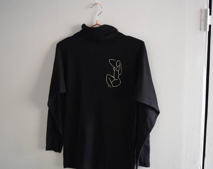 Black Cotton Nudie Turtleneck