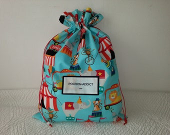 Circus print turquoise, marquees and scholars pet pouch.