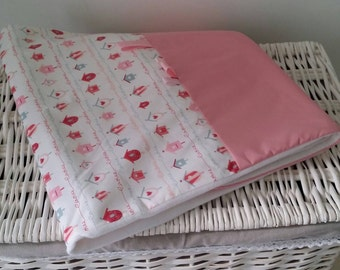 Baby Pink and white plaid blanket very soft.
