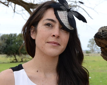 Ivory invited headdress with feather butterfly / white fascinator
