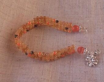 Seed Bead bracelet in orange/gold/bronze, very pretty