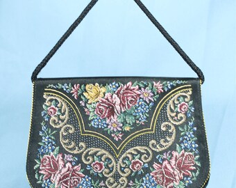 German bag embroidered in petit nedlee point.