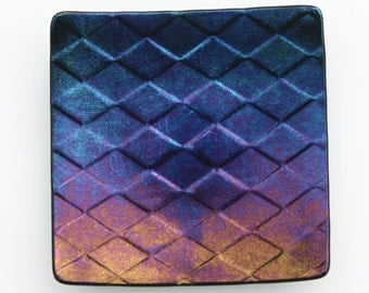 Fused glass harlequin dish in blue, gold and purple, an iridescent square glass bowl