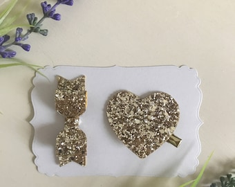 Glitter set of gold glitter bow and heart