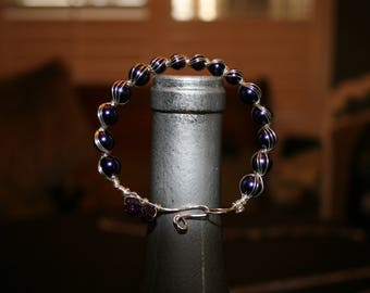 Wire wrapped bracelet with purple pearls