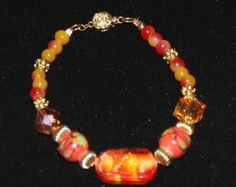 Georgous 7 1/2 Inch Orange, Rose, Yellow and Tangerine Beaded Bracelet.